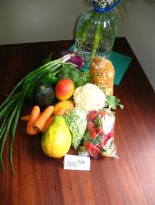 $5.50 - carrots, papaya, scallions, stawberries, pepper, zuchini, cauliflower, broccoli, mango, chopped veggies, etc.